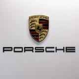 Porsche car logo. BRUSSELS - JAN 19, 2017: Porsche car manufacturer logo at the Brussel Auto Salon Motor Show Royalty Free Stock Image