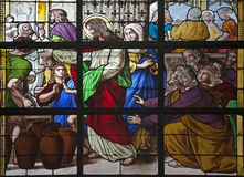 Brussels - Jesus by miracle in Cana. BRUSSELS - JUNE 21: Jesus by miracle in Cana. Detail of windowpane of church on June 21, in Brussels Stock Photo