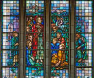 Brussels - Learning of Jesus from windowpane of National Basilica of the Sacred Heart built between years 1919 - 1969 royalty free stock photos
