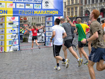 Brussels Marathon and Half Marathon. BRUSSELS, BELGIUM-OCTOBER 6: Participants arrive to the finish at Grand Place during Brussels Marathon and Half Marathon on royalty free stock photos