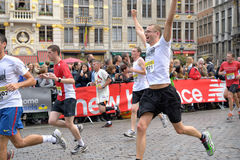 Brussels Marathon and Half Marathon. Participants arrive to the finish at Grand Place during Brussels Marathon and Half Marathon on October 6, 2013 in Brussels stock image