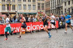 Brussels Marathon and Half Marathon. Participants arrive to the finish at Grand Place during Brussels Marathon and Half Marathon on October 6, 2013 in Brussels royalty free stock image