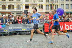 Brussels marathon. Participants arrive to the finish at Grand Place during Brussels Marathon and Half Marathon on October 6, 2013 in Brussels stock photography