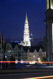 Brussels at night. Night view of the city Hall tower of brussels with the Basilica of Sacred Heart Dome in the background of the image Stock Images