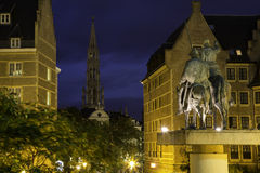 Brussels at night. City hall tower of brussels grand place, seen from a square at night, Belgium, Europa, with statue on the square Royalty Free Stock Photos