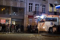 BRUSSELS - NOVEMBER 25, 2017: Riot police restoring order in Brussels after a peaceful protest against slavery became violent. BRUSSELS - NOVEMBER 25: Riot royalty free stock photo
