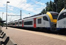 Brussels pubic transport trains. Waterloo, Belgium – June 11, 2017: A commuter train heading to Brussels at the Waterloo train station. Public transportation Stock Photos