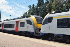 Brussels pubic transportation trains. Waterloo, Belgium – June 11, 2017: A commuter train heading to Brussels at the Waterloo train station. Public Royalty Free Stock Photo