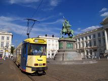 Brussels Royal Square & tram. The Brussels, Belgium Royal Square with the statue of Godfrey of Bouillon and tram, and the buildings of the Belgian federal Stock Image