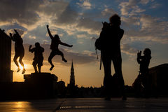 Brussels - Silhouette of jumped boys over the town on Monts des Arts in evening. Stock Photography