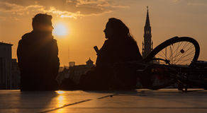Brussels - Silhouette of pair ower the town on Monts des Arts in evening. Stock Photo