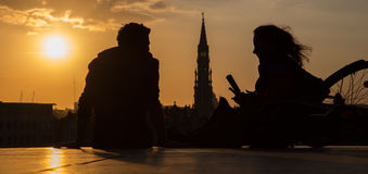 Brussels - Silhouette of pair ower the town on Monts des Arts in evening. Stock Photography
