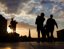 Brussels - Silhouette of posed boys over the town on Monts des Arts in evening. Stock Photos