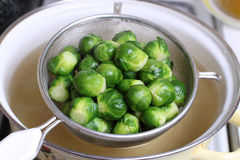 Brussels sprout in the colander. In pan Royalty Free Stock Images