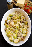 Brussels sprout gratin. With bacon and mushrooms Stock Photos