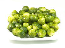 Brussels sprouts. Brussels sprouts on a white plate, isolated from the background stock photo
