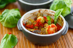 Brussels sprouts baked in tomato sauce Stock Photo