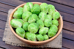 Brussels sprouts in a bamboo bowl Royalty Free Stock Photo