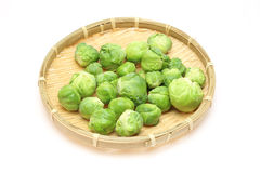 Brussels sprouts on a bamboo colander Stock Photography