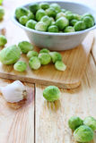 Brussels sprouts in a bowl aluminum. Fresh food Stock Photos