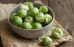 Brussels sprouts in a bowl. On an old wooden table Stock Image