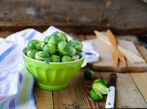 Brussels sprouts in a bowl on a wooden background. Brussels sprouts in a bowl Royalty Free Stock Photography