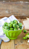 Brussels sprouts in a bowl on a wooden background. Brussels sprouts in a bowl on Stock Photography