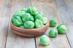 Brussels sprouts in a bowl on wooden background, horizontal. Brussels sprouts in bowl on wooden background, horizontal Stock Images