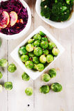 Brussels Sprouts, Cabbage and Broccoli on Table Stock Photos