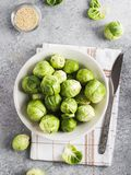Brussels sprouts cabbage fresh organic in jar on table in kitchen. Brussels sprouts cabbage fresh in jar on table in kitchen. Organic healthy farm vegetable food Stock Images