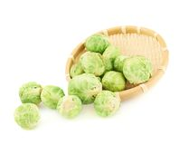 Brussels sprouts falling out of the basket Stock Photo