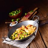 Brussels Sprouts with ham ,honey and roasted potatoes Royalty Free Stock Image