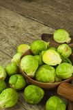 Brussels sprouts on old wooden table. Homework fresh vegetables. Growing vegetables on the farm. Preparing vegetarian food. Diet f Stock Images
