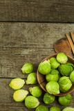 Brussels sprouts on old wooden table. Homework fresh vegetables. Growing vegetables on the farm. Preparing vegetarian food. Diet f Royalty Free Stock Photography
