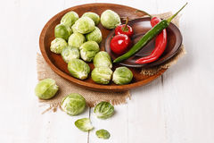 Brussels sprouts over rustic wooden background Royalty Free Stock Images