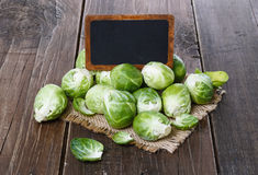 Brussels sprouts over rustic wooden background Royalty Free Stock Image