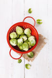 Brussels sprouts over rustic wooden background Stock Photos