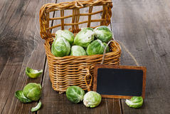 Brussels sprouts over rustic wooden background Stock Images