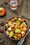 Brussels sprouts pumpkin apple chicken stew Stock Image