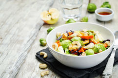 Brussels sprouts red cabbage carrot cashew apple salad with mapl Stock Photography