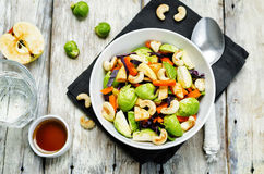Brussels sprouts red cabbage carrot cashew apple salad with mapl Stock Photo