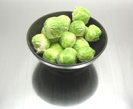 Brussels sprouts on reflecting matting Royalty Free Stock Photos