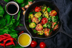 Brussels sprouts roasted with tomatoes, basil and cheese Stock Photography