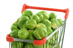 Brussels sprouts in a shopping trolley. On white  background Royalty Free Stock Photos