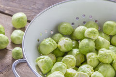 Brussels sprouts in a sieve on a table Stock Photos