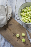 Brussels sprouts in a sieve on a table. Brussels sprouts in a sieve on a wooden table Stock Photography