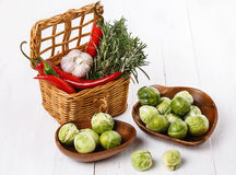 Brussels sprouts and species over rustic wooden background Royalty Free Stock Images