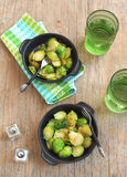 Brussels sprouts with sweet onions. Served on the table Royalty Free Stock Photo