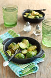 Brussels sprouts with sweet onions. Served on the table Stock Photos