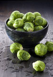 Brussels Sprouts Vegetables. A bowl of brussels sprouts sprayed with water Stock Photo